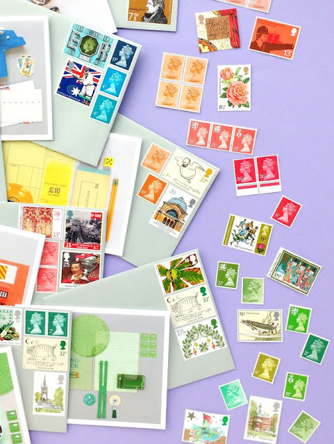 colourful envelopes and coordinating postage stamps