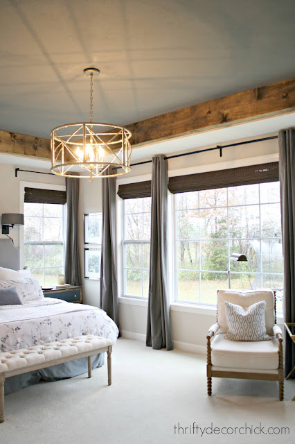 Bedroom with dark gray wood beam tray ceiling