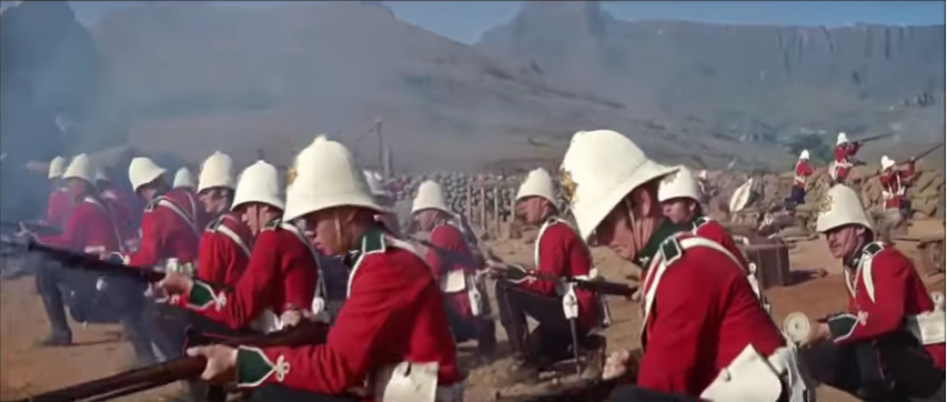 Old-fashioned british soldiers reload their weapons as they charge the enemy to illustrate a blog post about epic war movie battle scenes
