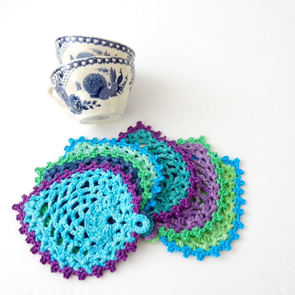 Free crochet pattern peacock style pineapple coasters free crochet pattern coaster peacock feather thecuriocraftsroom the curio crafts room general information what you need dt1010fo