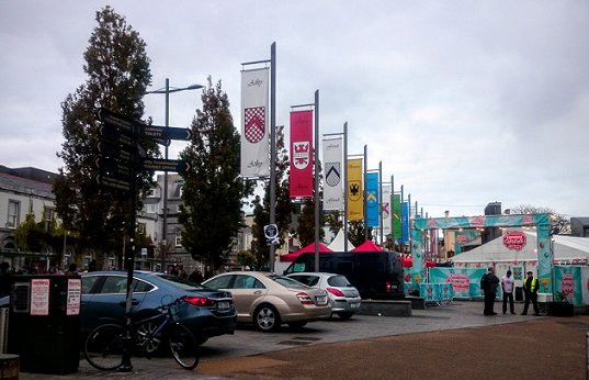 Galway Comedy Festival tent on Eyre Square, October holiday weekend 2015 - with official cars parked on the Square beside it