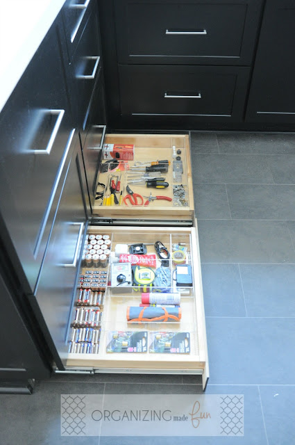 Toekick drawer organized used as junk drawer :: OrganizingMadeFun.com