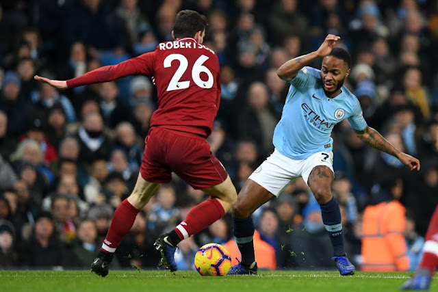 Liverpool Robertson and Manchester City Raheem Sterling