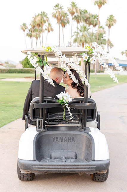 bride and groom in a golf cart at the AZ Golf Resort