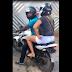 Esposa flagra marido entrando com amante de moto em motel
