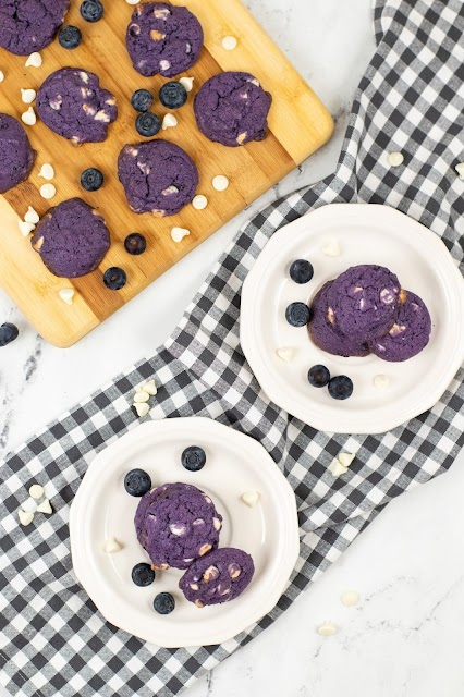 cookies on white plates and wooden cutting board