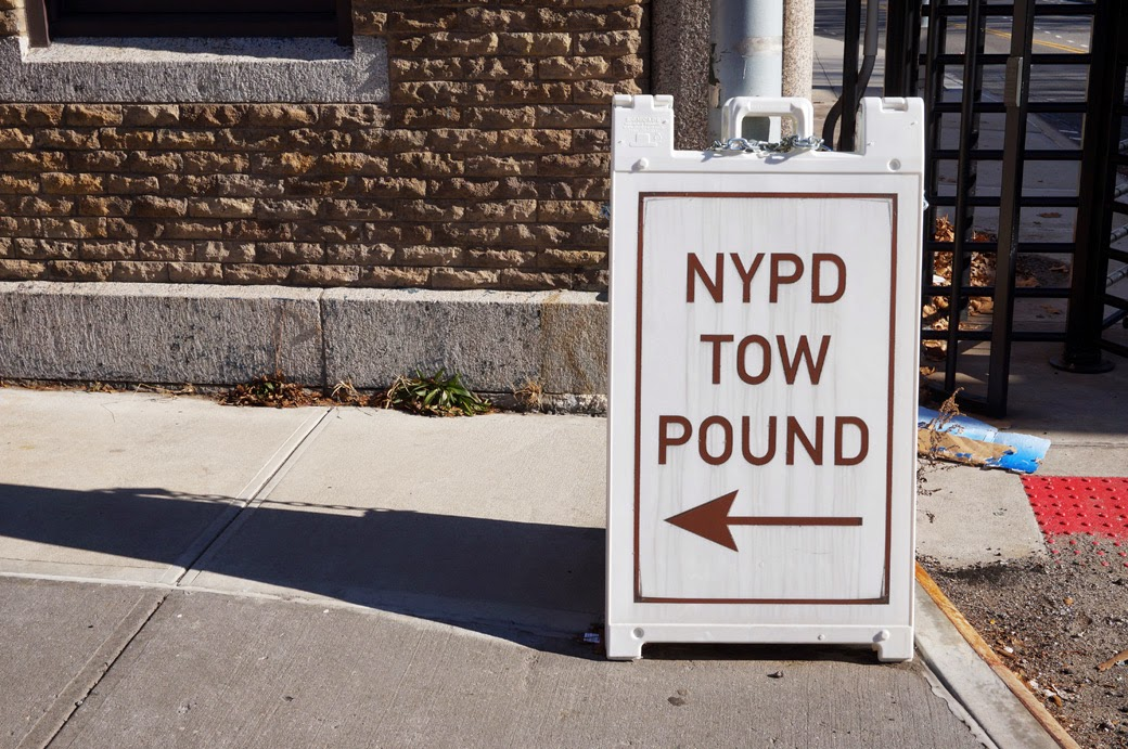 Tow Pound Sign in front of Sands Street Gatehouses