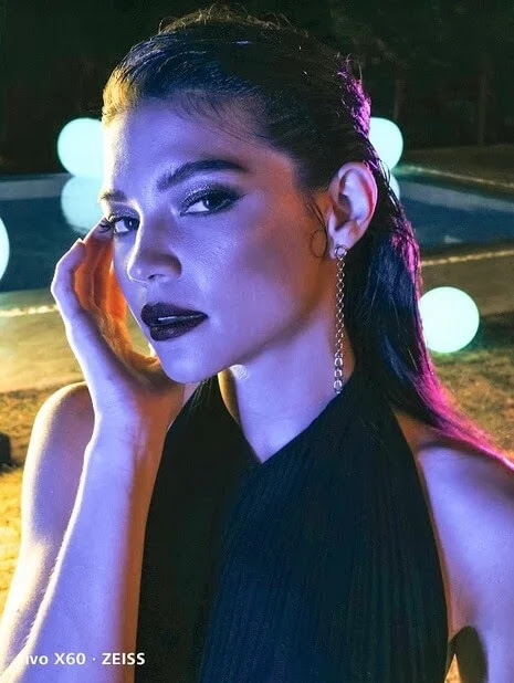 The evening is only getting better. Using the vivo x60's HDR Super Night Shot, photographer Xander Angeles shoots a vividly lit portrait of Rhian Ramos in a dark area.