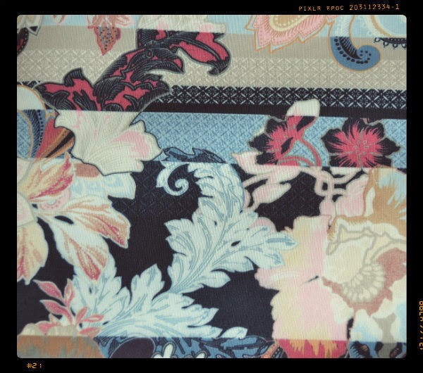 close up of paisley fabric dress
