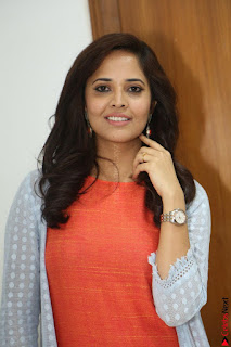 Actress Anasuya Bharadwaj in Orange Short Dress Glam Pics at Winner Movie Press Meet February 2017 (60).JPG