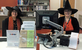 Two Davis Library staff in costume