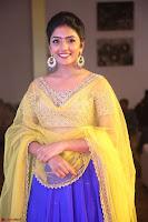 Actress Eesha in Yellow Choli Blue Ghagra at Darshakudu music launch 049.JPG