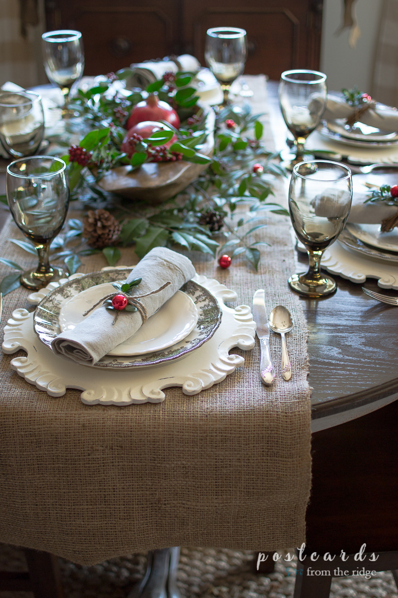 The burlap runner is a great way to anchor this rustic Christmas tablescape.
