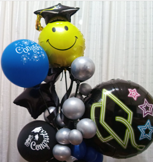 Ballondekoration zur Graduierung mit Folienballon und  Latexballons.
