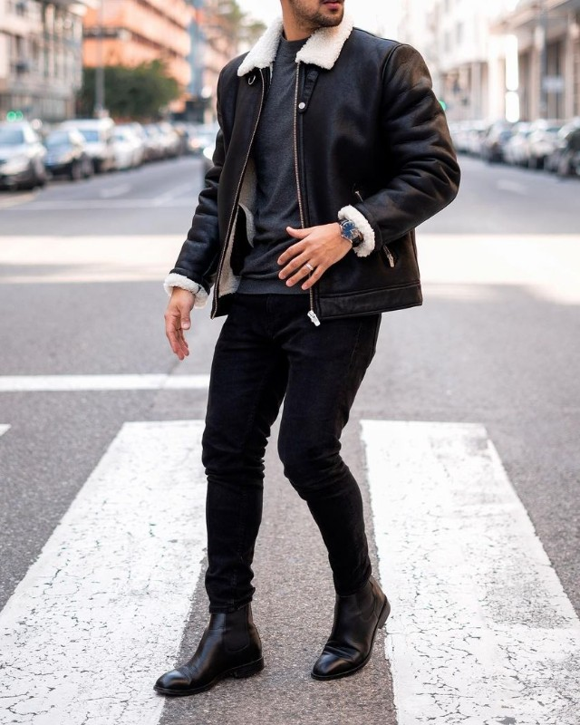 Man in Leather jacket, jeans, t-shirt and Chelsea boots.