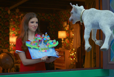 "In a movie still for Disney's 2019 film ""Noelle,"" Noelle Kringle (Anna Kendrick) talks to her favorite reindeer, Snowcone, who is flying outside her window."