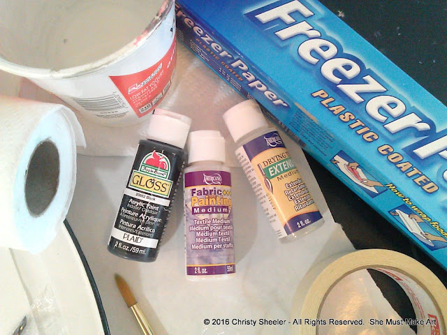 The main supplies needed for the black lettering on the fabric banner.