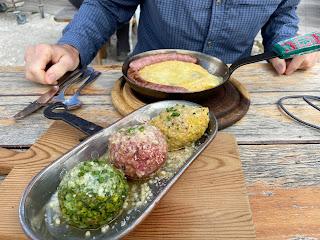 Three types of canederli and polenta at Rifugio Pian di Cengia.