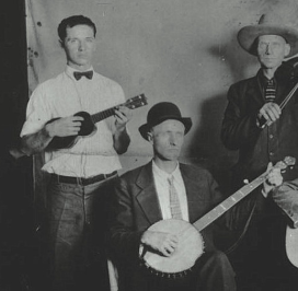 Iver Edwards on ukulele with G Stoneman, banjo, and E Dunford, fiddle.