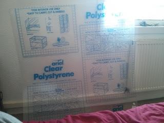 Plexi lap védőfóliával a nagy méretű puzzle kerethez