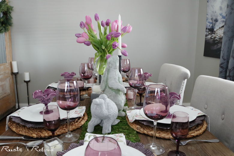 Spring tablescape using pinks, purples, moss and gorgeous concrete bunnies for a spectacular table