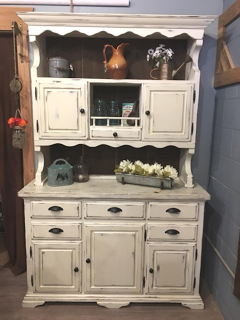 hutch with distressed paint job