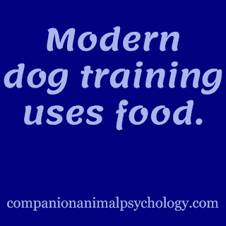 The ultimate dog training tip: Text reads, Modern dog training uses food.