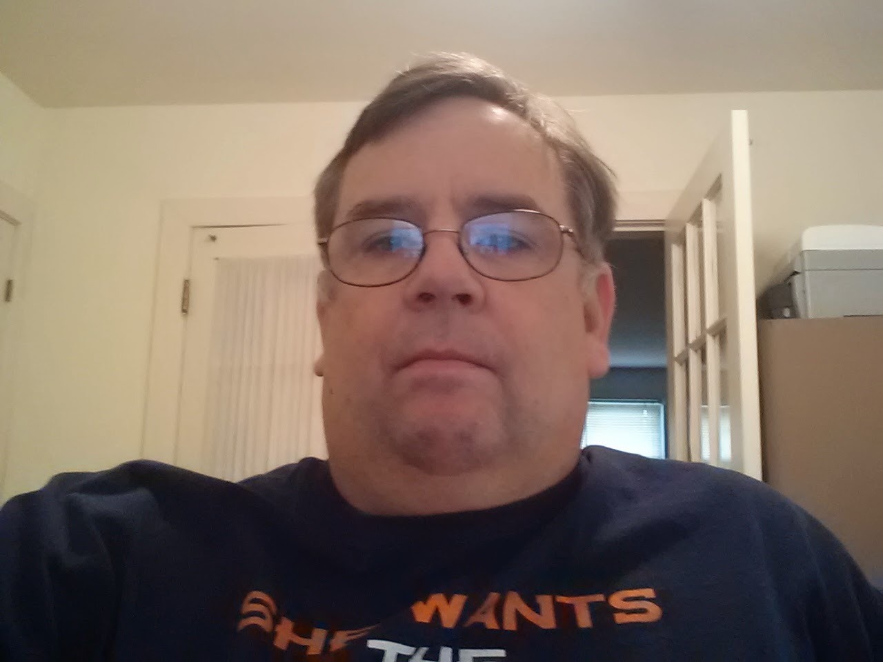 Image of Don recovering nicely at home in one of many Denver Broncos T-shirts.