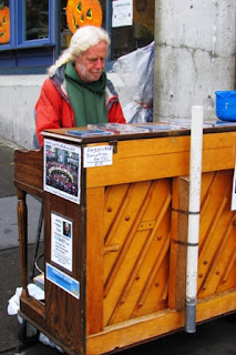 Johnny Hahn, a busker in Seattle, plays piano