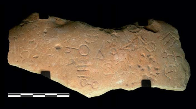 Iron Age stone slab engraved with ancient symbols unearthed in farmer's field in Spain