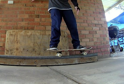 Backside 50-50 Grind by TET