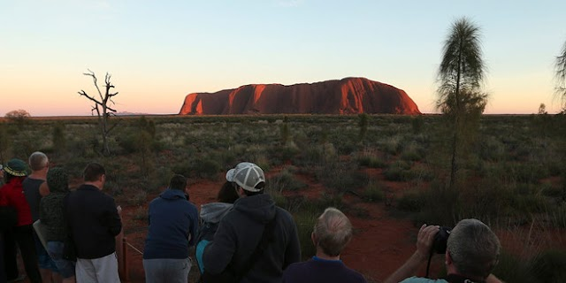 Visitors flock to the sacred mountain of Australia ahead of the permanent closure