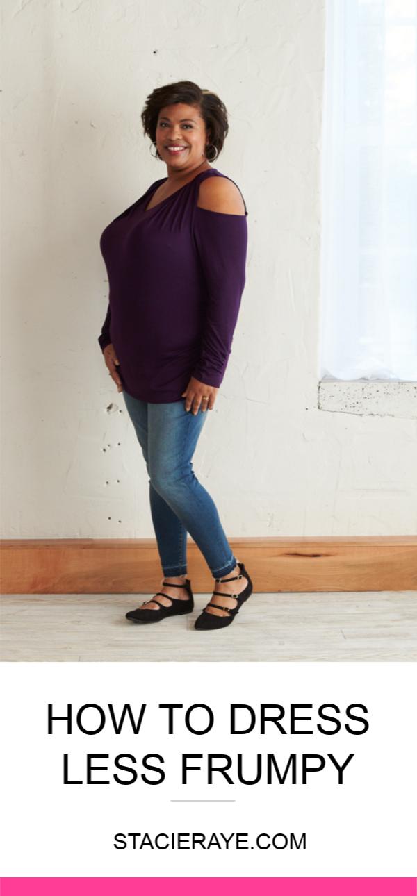 a woman wearing a purple cold shoulder shirt