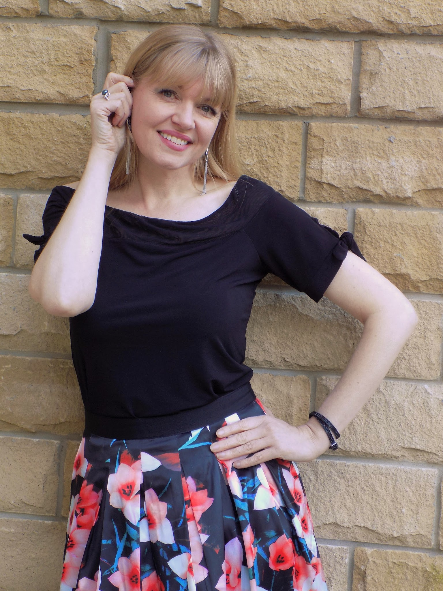 What Lizzy Loves wears Kaleidoscope floral skirt and Bardot top