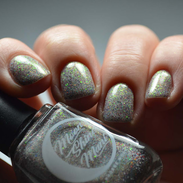 grey holographic nail polish with glitter low light swatch