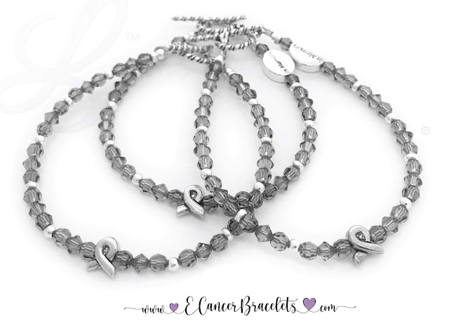 """Three Grey Ribbon Bracelets are shown with Twisted Toggle Clasps. Two have IN MEMORY beads. Sizes: 7"""" and 7 1/2"""""""