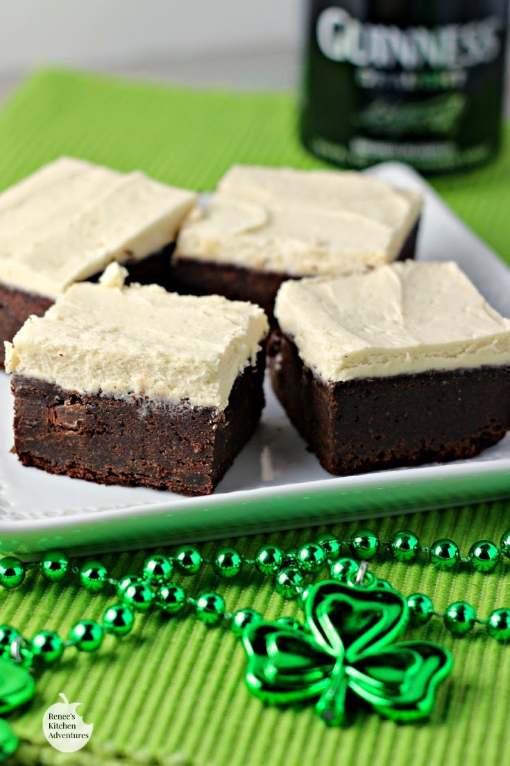 Guinness Brownies with Maple Buttercream Frosting on a white plate vertical image