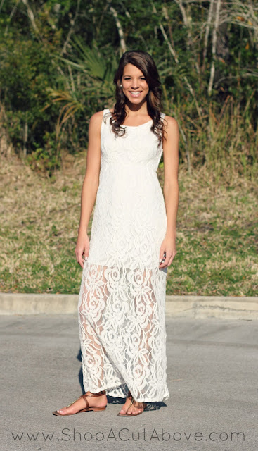 Model wearing casual white lace dress and sandals
