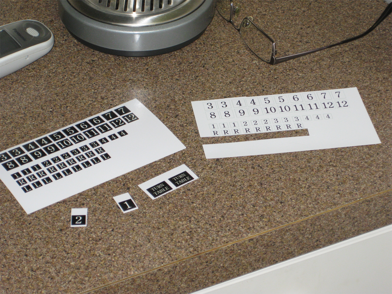 Homemade number and letter labels printed on photo paper for Atlas selectors and Atlas switches
