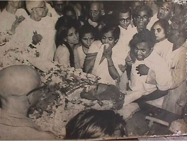 Dr. Ambedkar's dead body was brought to his residence- Rajgruha in Bombay. From right are Dahivalkar Buwa, Mr. Yashvantrao Ambedkar, Mrs. Savita Ambedkar, Mrs. Thokle, Mr. Sadashivrao Bagaitkar, leader of the Socialist Party. Behind Yashavantrao Ambedkar are Mr. Shankarmama Dhotre (brother of Ramabai) and Mr. H. R. Mahajani, the then editor of Loksatta, Bombay