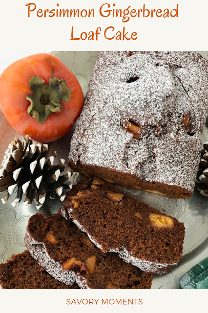 Top of a finished persimmon gingerbread loaf ckae topped with powdered sugar.