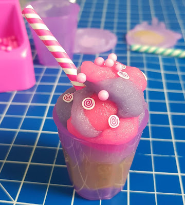 So Slime DIY two colour ice cream mixture in cup with pretend straw and sprinkles