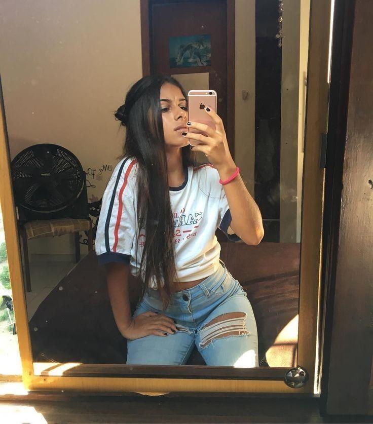 Fotos en el espejo sentada