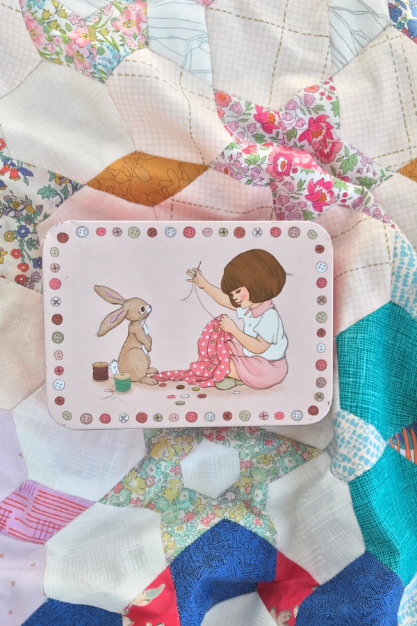 Belle and Boo sewing tin on English Paper Pieced quilt by Ange from A Little Patchwork | Shannon Fraser Designs