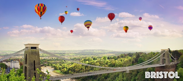 Hot air balloons flying over clifton suspension bridge