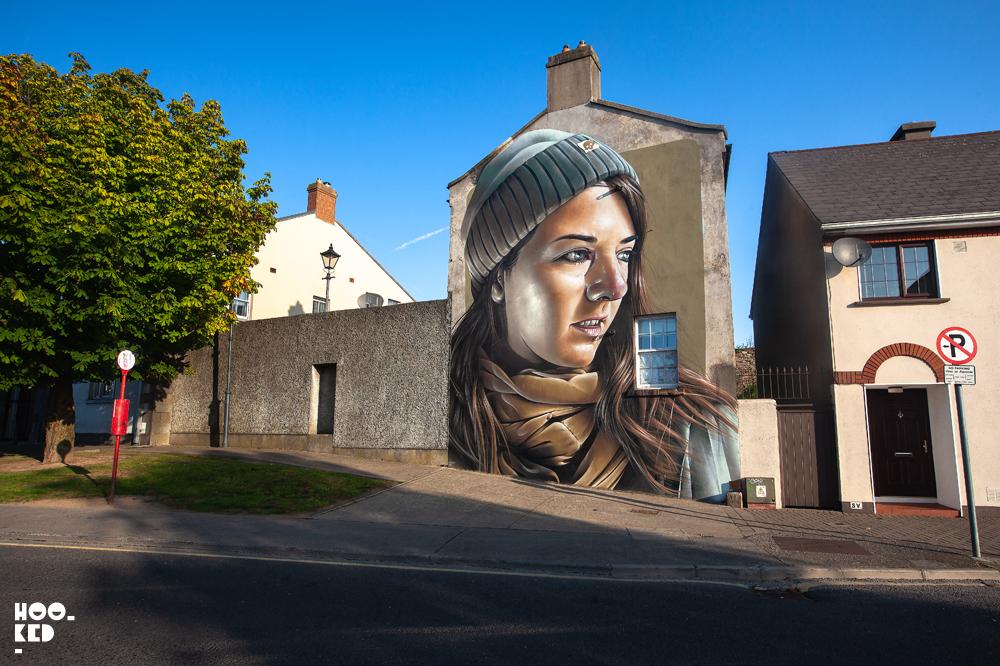 Waterford street art festival, photorealistic portrait of a woman by street artist Smug