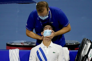 Nole played with a sore neck and received treatment on court