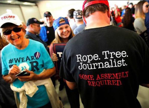 "Donald Trump supporter wears a t-shirt with the caption ""Rope. Tree. Journalist. Some assembly required."""