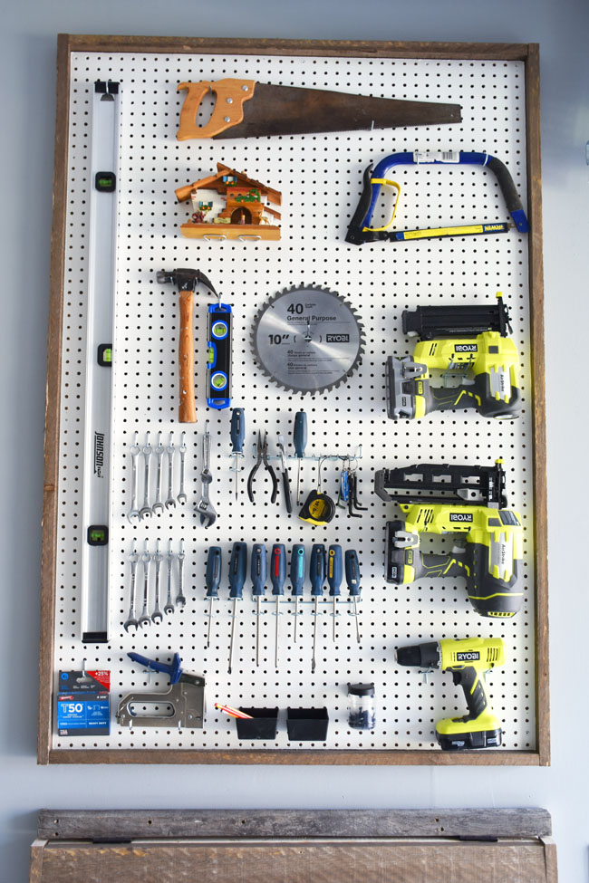Woman in real lifethe art of the everyday garage organization we tossed and decluttered and then went to work to create a diy pegboard to organize our ryobi power tools saws hammer nails and assorted small tools publicscrutiny Images