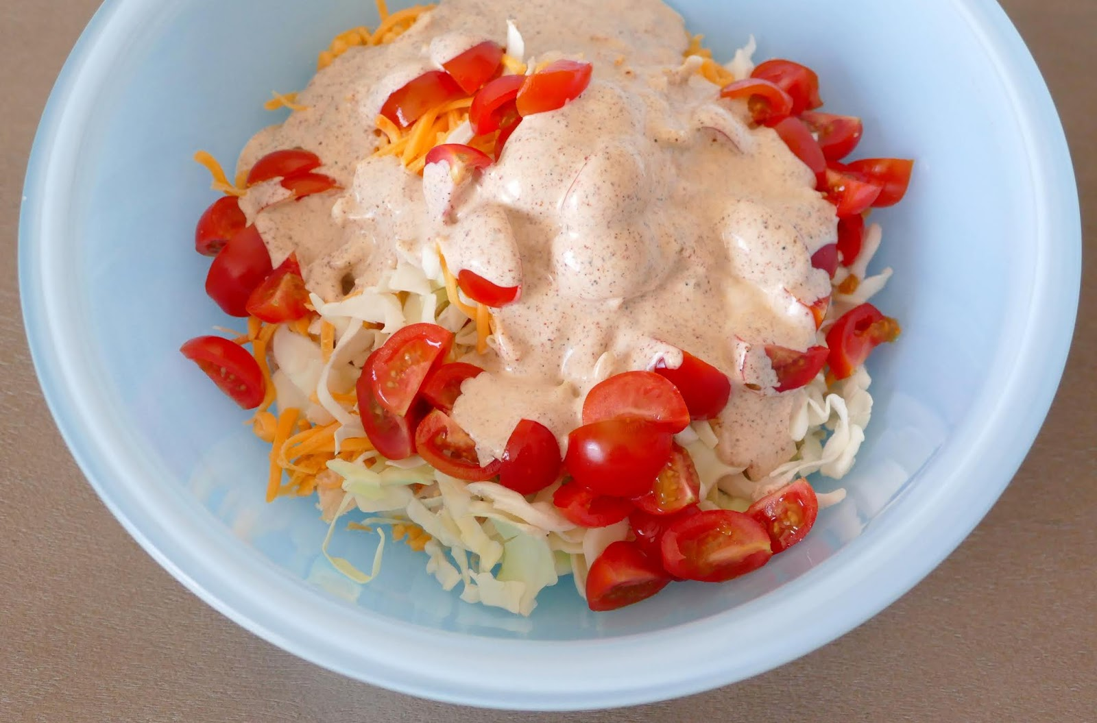 A delicious and unique Southwest Mexican flavored side dish! This coleslaw is perfect served at a BBQ, picnic or for taco night. Serve in spinach or tomato wrap for lunch or dinner! Made with chicken, cheddar cheese, cumin, chili powder, lime juice, ranch and more!